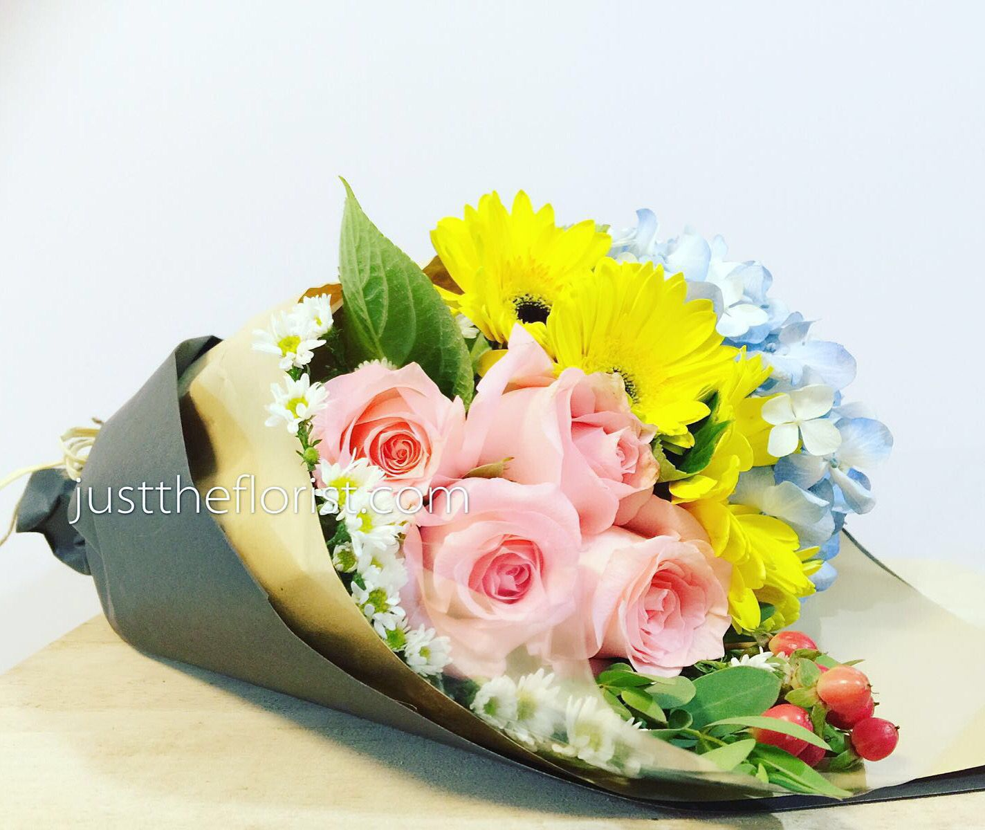 What can be better than receiving this colourful bouquet filled with blue hydrangea, bright yellow gerbera and sweet pink roses. Send & save 20% today! #justtheflorist #sgflorist #surprise #birthday #gerbera #hydrangea #rose #tgif