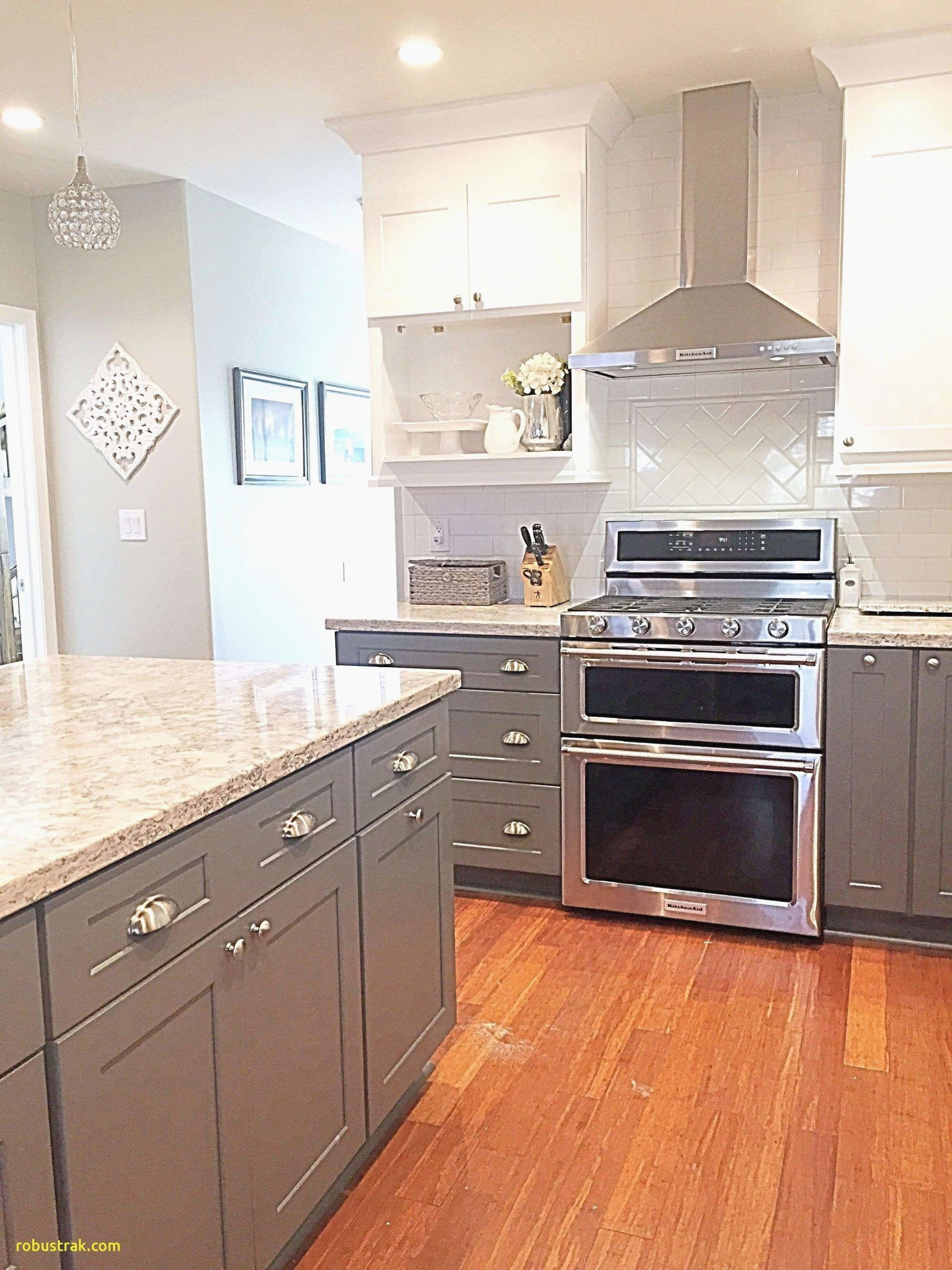 A Beautiful Combination Of Stone Dark Cabinetry And Oak In This Sophisticated Family Minimalist Kitchen Design Modern Kitchen Interiors Modern Kitchen Design