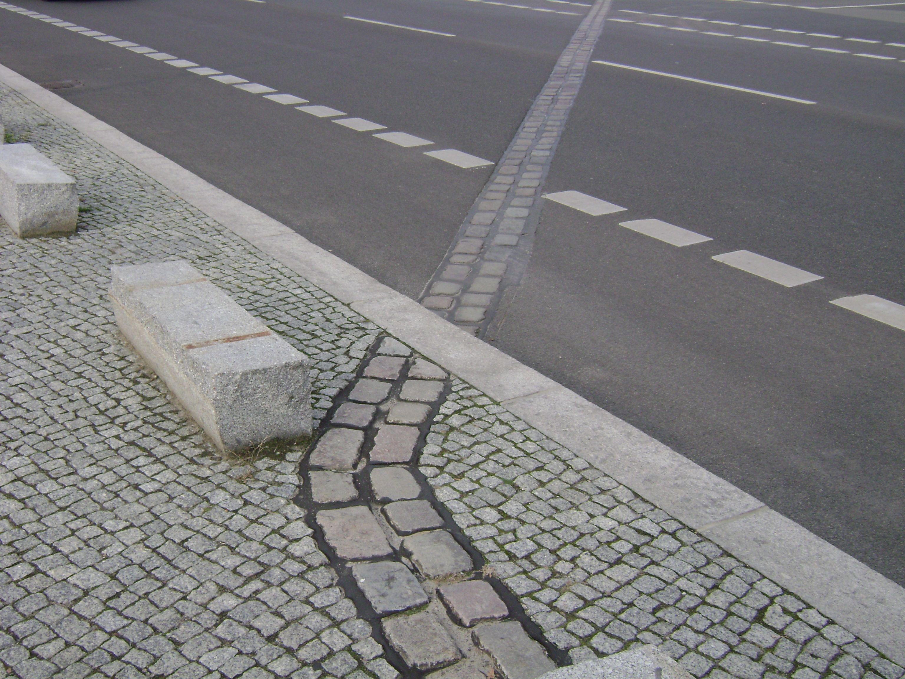 line of bricks marking where the former berlin wall stood on berlin wall id=87112