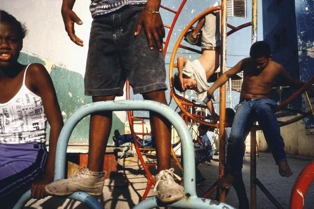 Alex Webb CUBA. 2000. Havana. Children playing in a playground.