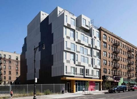 An apartment building constructed of modular units in New York City ...
