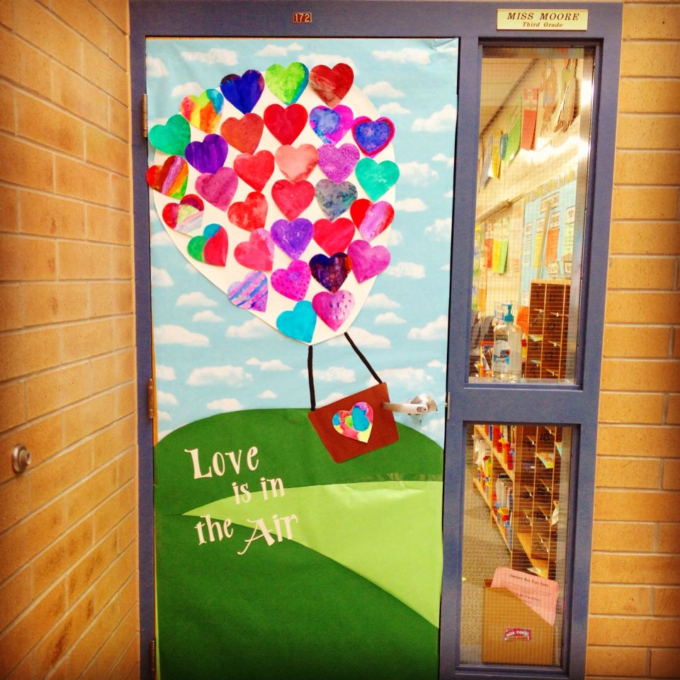 I am so in love with our Valentines door! My kids painted the hearts ...