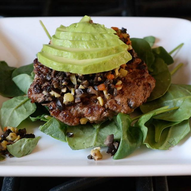 OLIVE TAPENADE BURGERS -2 lbs ground beef -3/4 c olive tapenade + more for toppings -1 tsp of salt, pepper, coriander, minced onion, garlic powder, paprika and (optional) chili powder -a few dashes balsamic -sliced avocado and handful of spinach (Olive tapenade is 1 can black olives +  1 cup green olives with pimentos. Chop together)  1) Mix all ingredients together except avocado and spinach. Save some olives