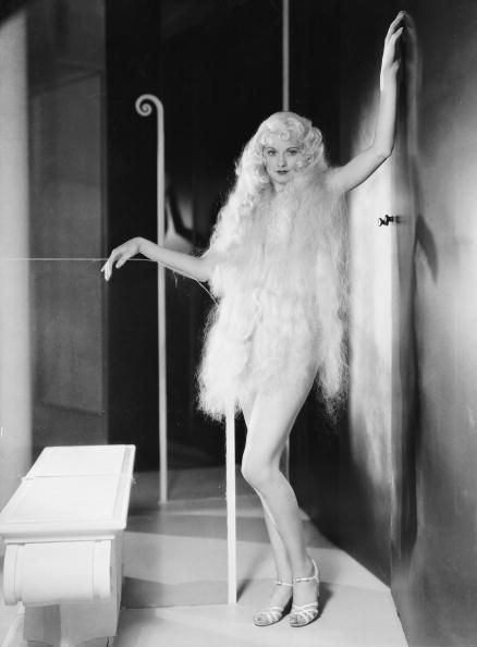1933: Lucille Ball (1911 - 1989) wears a long blonde wig and a pair of high heels in a full-length promotional portrait for the film 'Roman Scandals', directed by Frank Tuttle. Photo via John Kobal Foundation/Getty Images. °