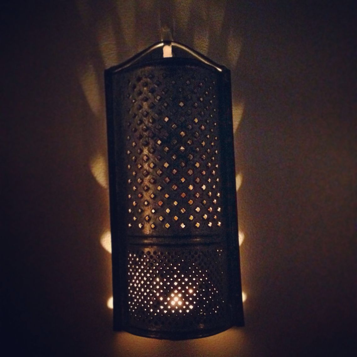 My old grater made into a candle sconce.