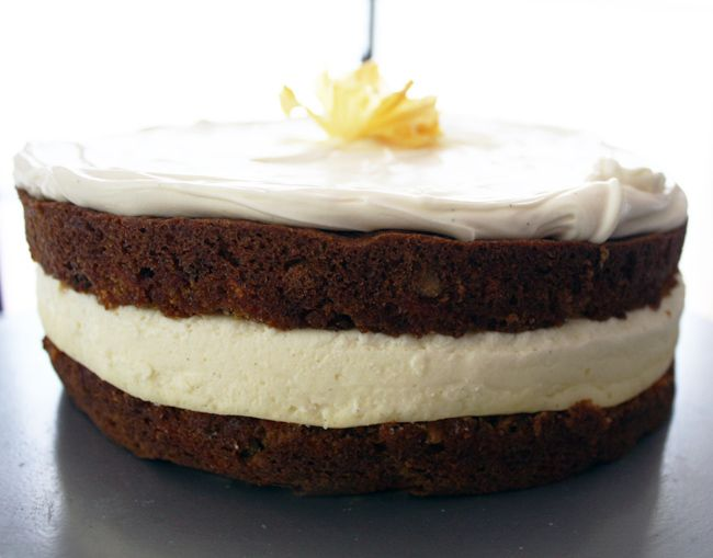 """Carrot Cake Cheesecake  - What a beautiful cake this is! The cheesecake part of this cake is baked separately from the 2-8""""carrot cakes. Once it has been cooled, it is placed between the cakes, than it is topped & filled with a heavenly vanilla bean mascrapone frosting. This lady than made Pineapple Flowers as an added decoration. The link is provided with her recipe, if you'd like to try making those too."""
