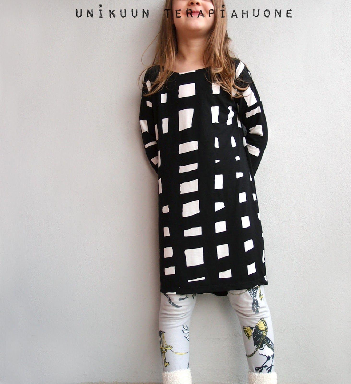 Black and white dress sewed by Unikuun terapiahuone. Fabric is from Marimekko.