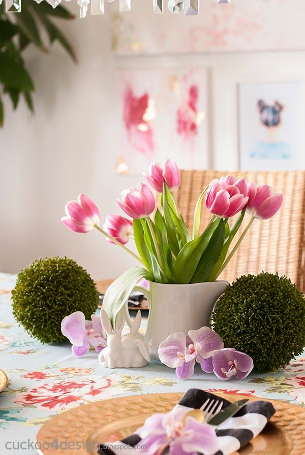 love this dining area with the spring floral tablecloth and modern art
