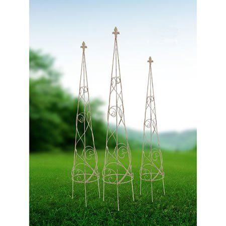 """Plant Stand Garden Topiary Trellis ii Set Of 3 by FantasticDecor. $89.99. Buy multiple items, save on shipping. Grow a vine or use it for design! Place these Metal Topiary Trellis into the ground in your beautiful flower garden for a stylish look, or use it to grow a beautiful vine with blooming flowers. This set of three is constructed of metal. A must-have for any beautiful garden. Measures L: D9""""x46"""", M: D7""""x42"""", S: D5""""x34"""". Set of three."""