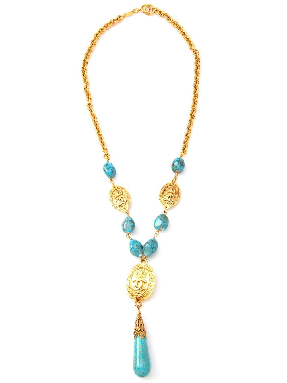 Gold tone metal turquoise and coin necklace from Chanel Vintage featuring turquoise stones, logo branded coin pendants and a spring ring fastening.