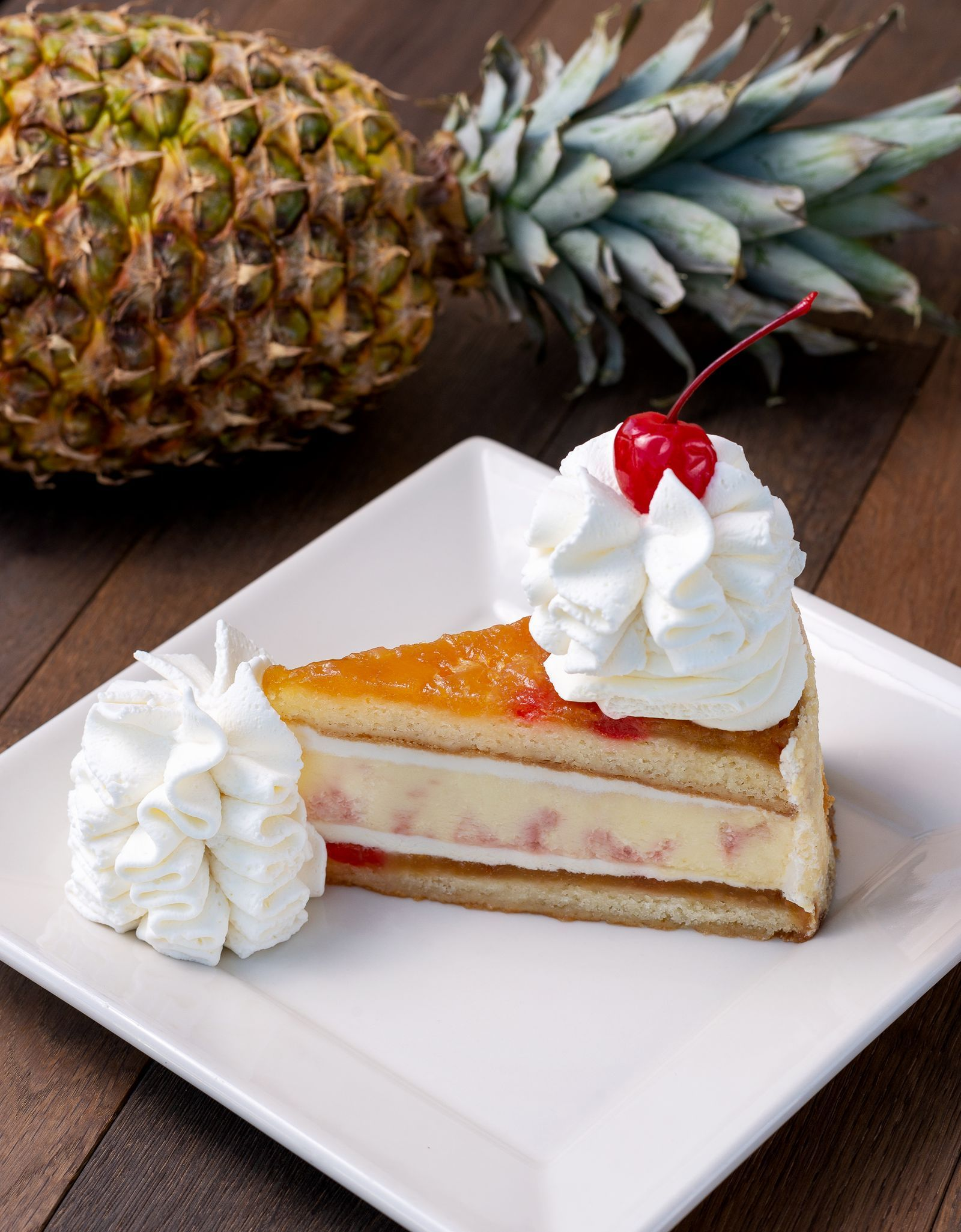 The Cheesecake Factory's Latest Flavor Has A Maraschino Cherry Swirl And Two Layers Of Pineapple Upside-Down Cake #cheesecakefactoryrecipes