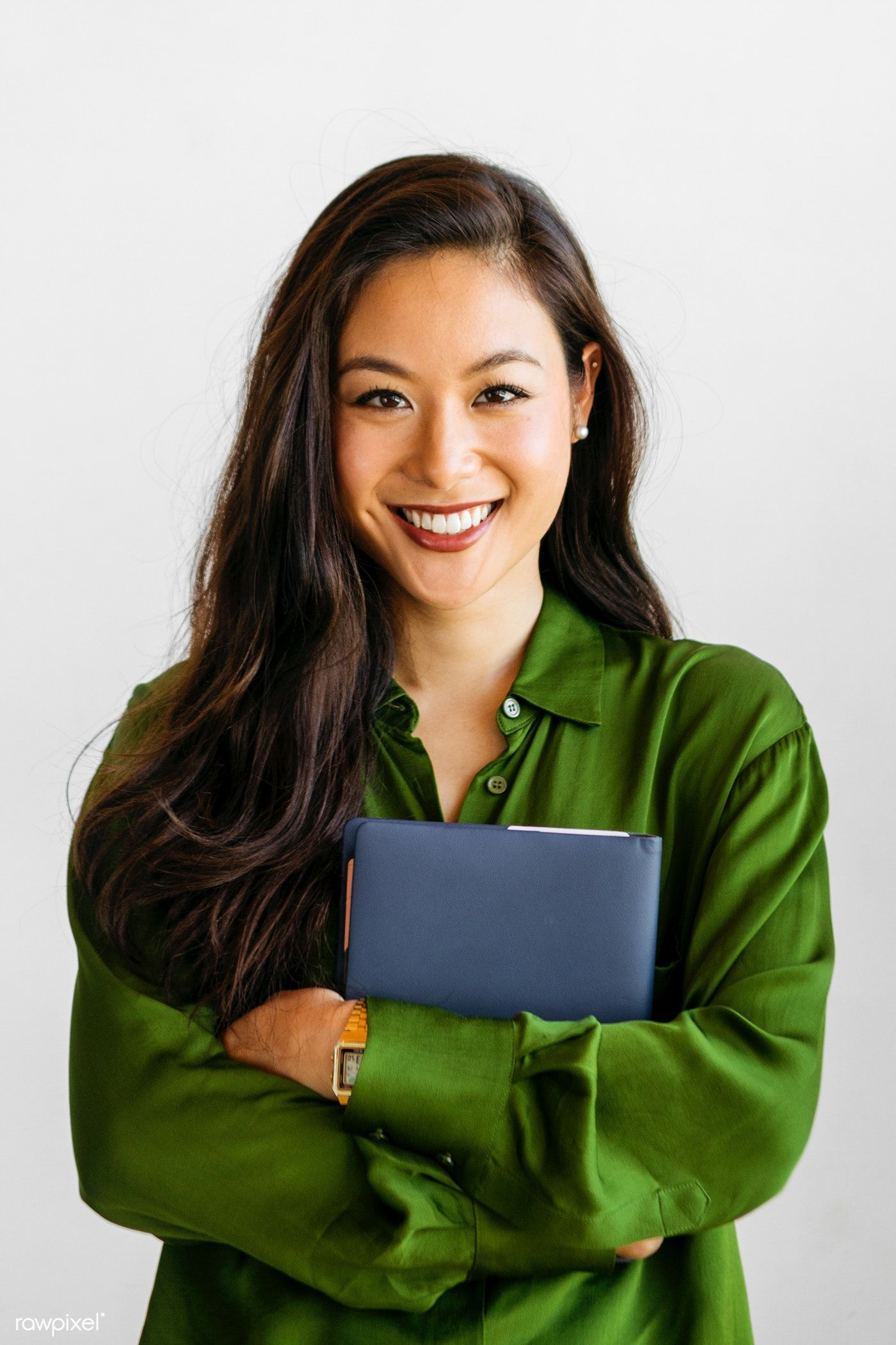 Download Premium Image Of Cheerful Woman In Green Shirt Holding Blue Branding Photoshoot Inspiration Business Pictures Business Portrait