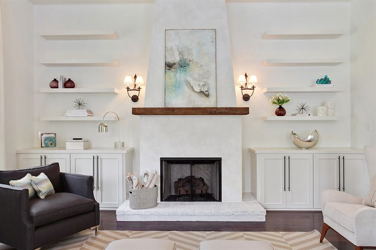 Simply stunning living room features a white plastered fireplace