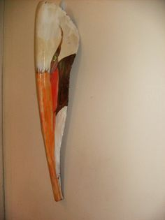 This is one of a kind art on a palm frond. The fronds I use are usually from the Queen palm that are very sturdy almost like a hunk of wood. The shape of this palm inspired me to paint a pelican head. Palm frond is sanded and trimmed so the acrylic paint will go on smoothly. When I finish, I coat with varnish to protect the frond. There is hanger on back and It can be hung outside in covered area or somewhere in your home. The size is approximately 22x 7.