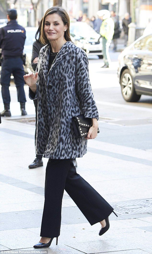 Letizia, 44, looked stunning in an animal-print coat and leather ensemble  as she waved to. b636080b7435