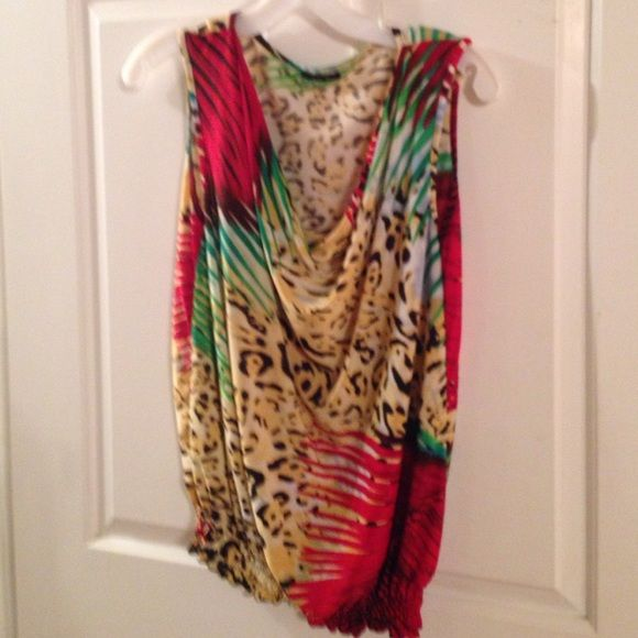 Sleeveless top! Many colors make up this cute and cool summer top. Stretch polyester. Tops Blouses
