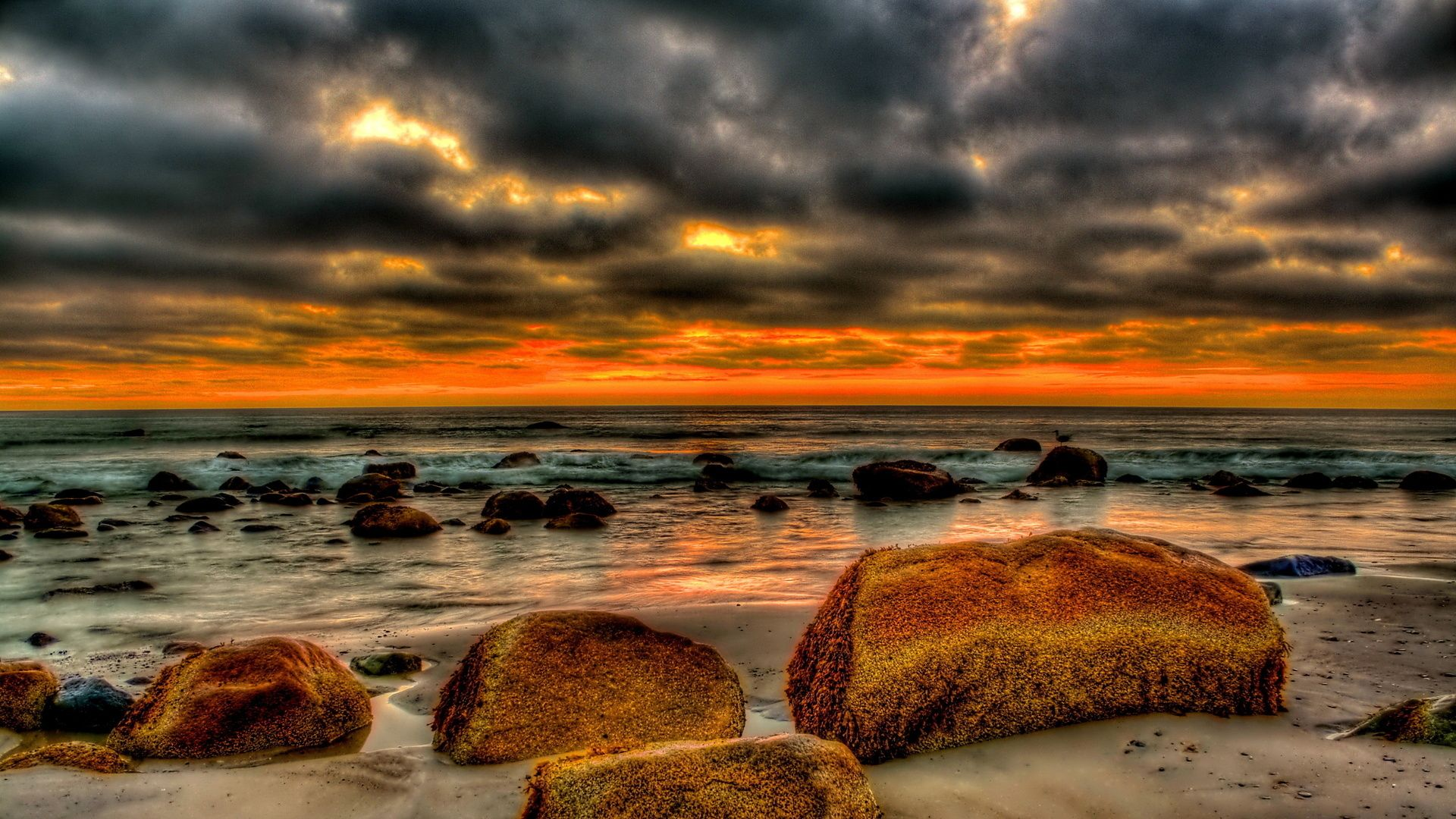 beautiful beach strewn with rocks at sunset hdr hd desktop