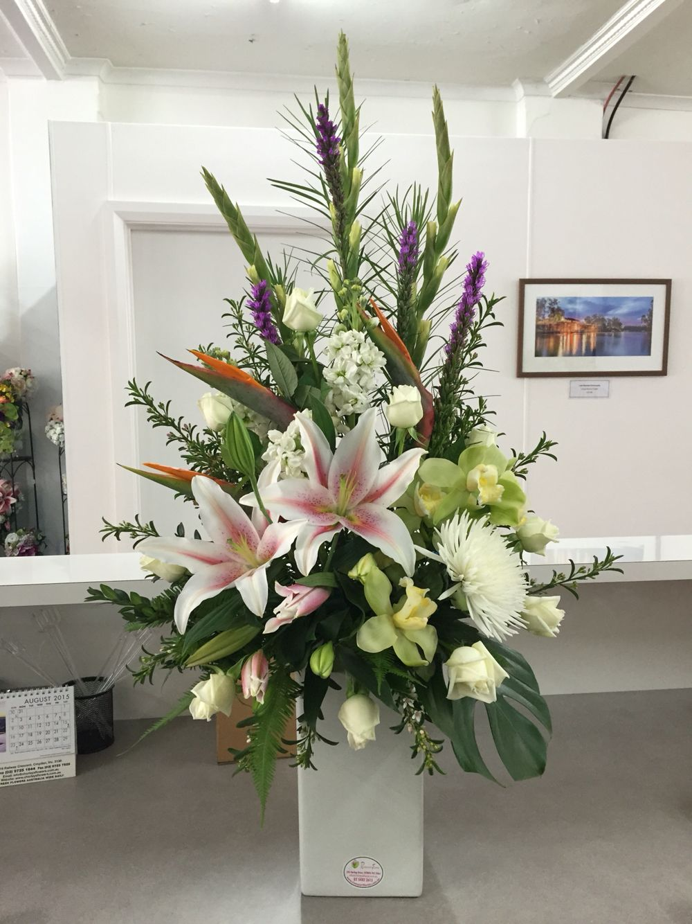 Large flower arrangement of gladiolus liatris cymbidium orchids large flower arrangement of gladiolus liatris cymbidium orchids lilies disbud chrysanthemum and izmirmasajfo Image collections