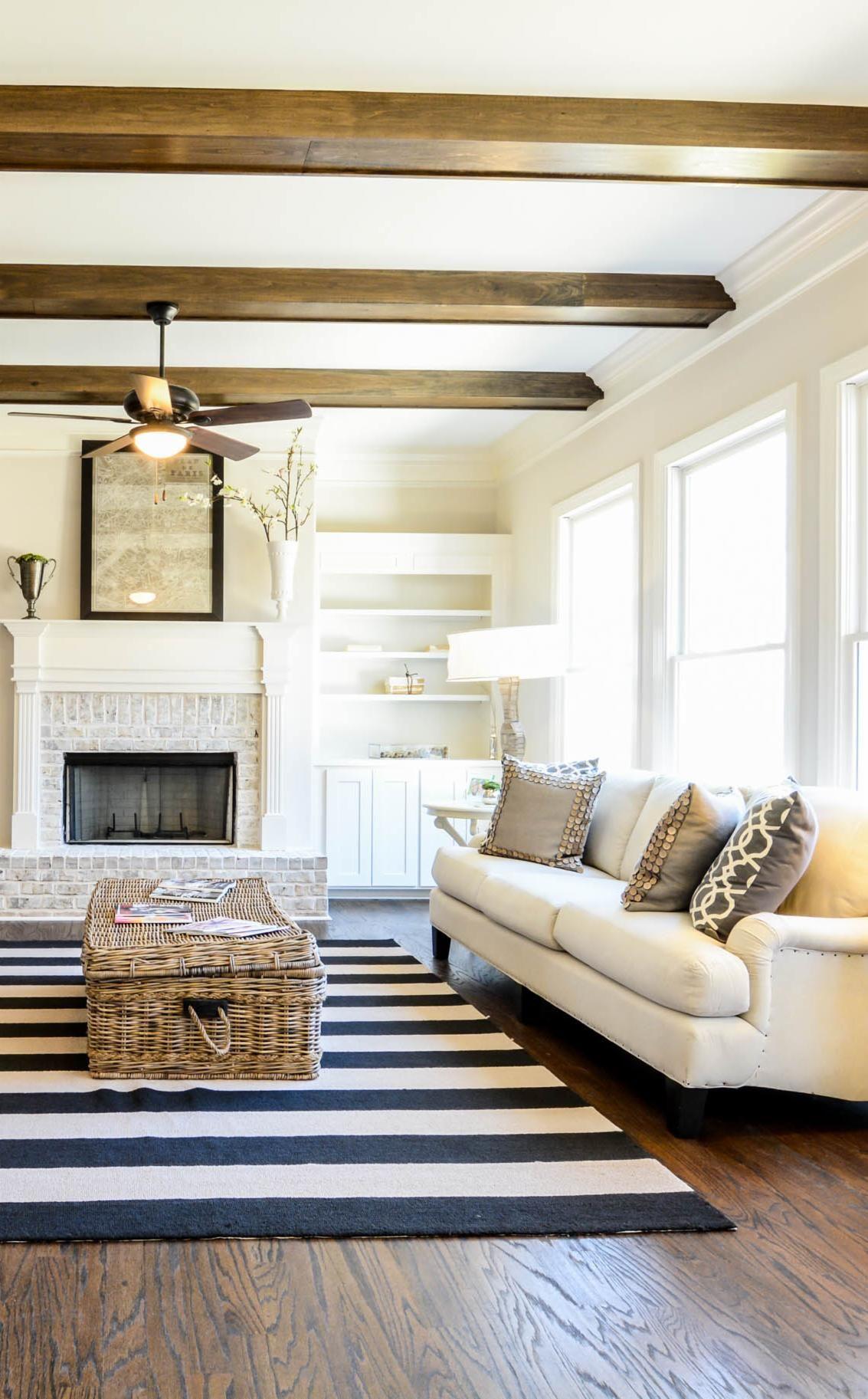 Beautiful hardwood floors and wooden beams give