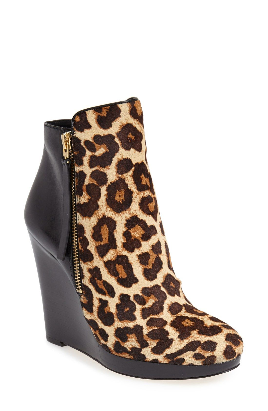 c5486057d46 Can t go wrong with extra height and a leopard print. Love these Michael  Kors booties.