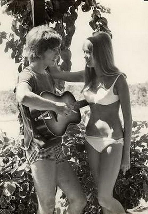 George Harrison serenading Pattie Boyd.