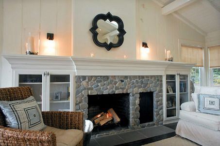 bookcase design next to rock fireplace - Google Search