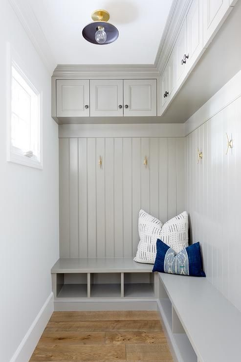 Gray Mudroom Features An L Shaped Bench Ed With Under Seat Shelves And Topped White Blue Pillows Placed Against A Beadboard