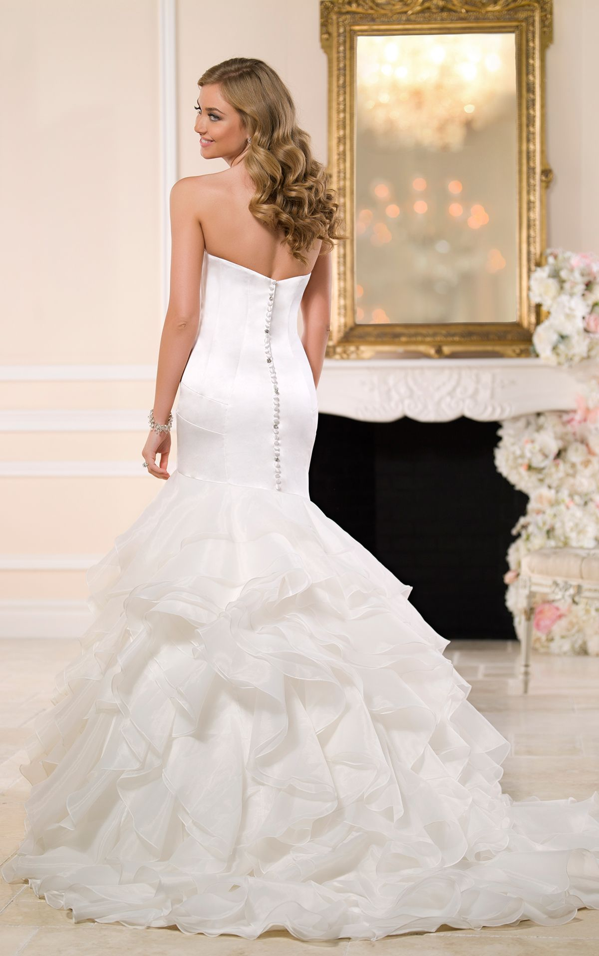 Read more about this satin fit-and-flare wedding dress featuring layers of Organza on the skirt and court train with a sweetheart neckline and modern fitted bodice.