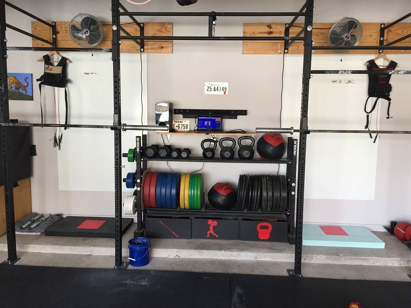 Contemporary garage gym with wall mounted lcd tv useful and