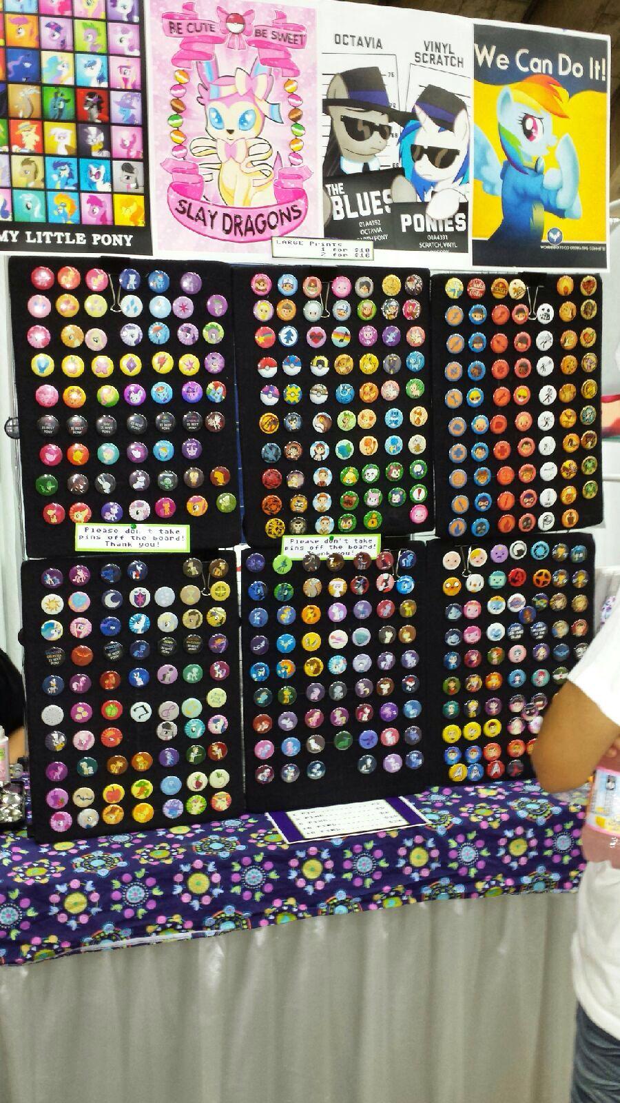 Pinback button display in vendor hall at Bronycon 2014