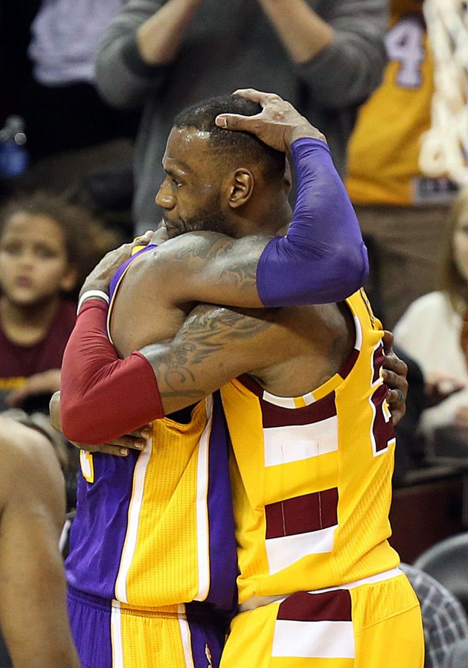 3bd6bfc3899 Los Angeles Lakers forward Kobe Bryant hugs Cleveland Cavaliers forward LeBron  James in the fourth quarter. Wednesday