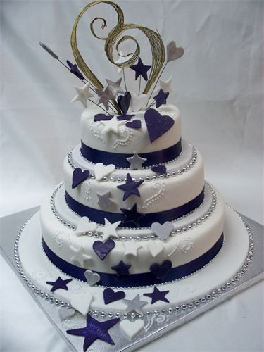 3 Tier Wedding Cake With Stars Hearts Koru Heart Topper
