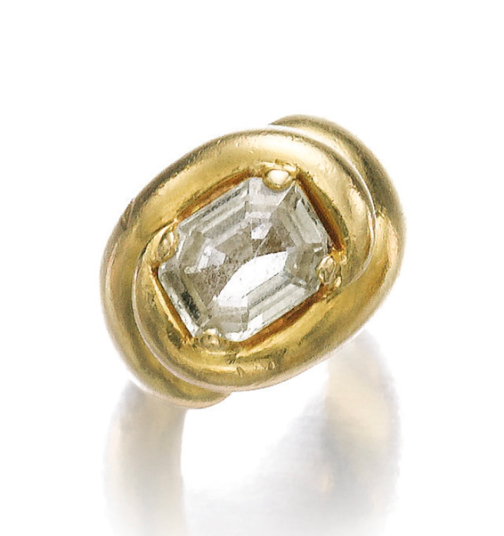 YELLOW SAPPHIRE RING, 'HEUREUX', SUZANNE BELPERRON, 1970-1974.  The step-cut yellow sapphire, set to a mount of swirl design, size 47, French assay and maker's mark for Darde & Cie.