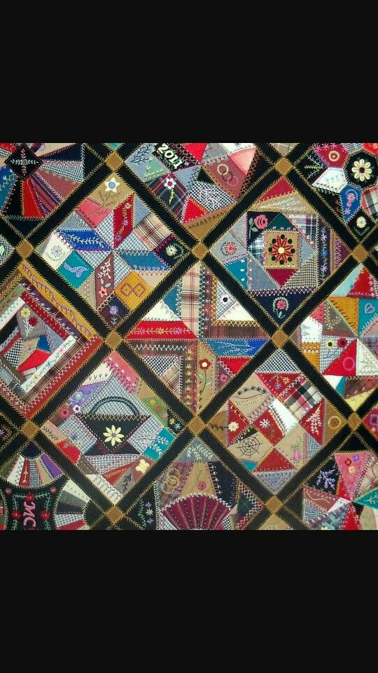 Crazy quilt with traditional quilt patterns.