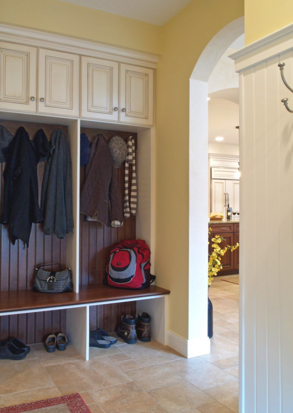 Awesome dark brown stained oak wood mudroom locker with classical