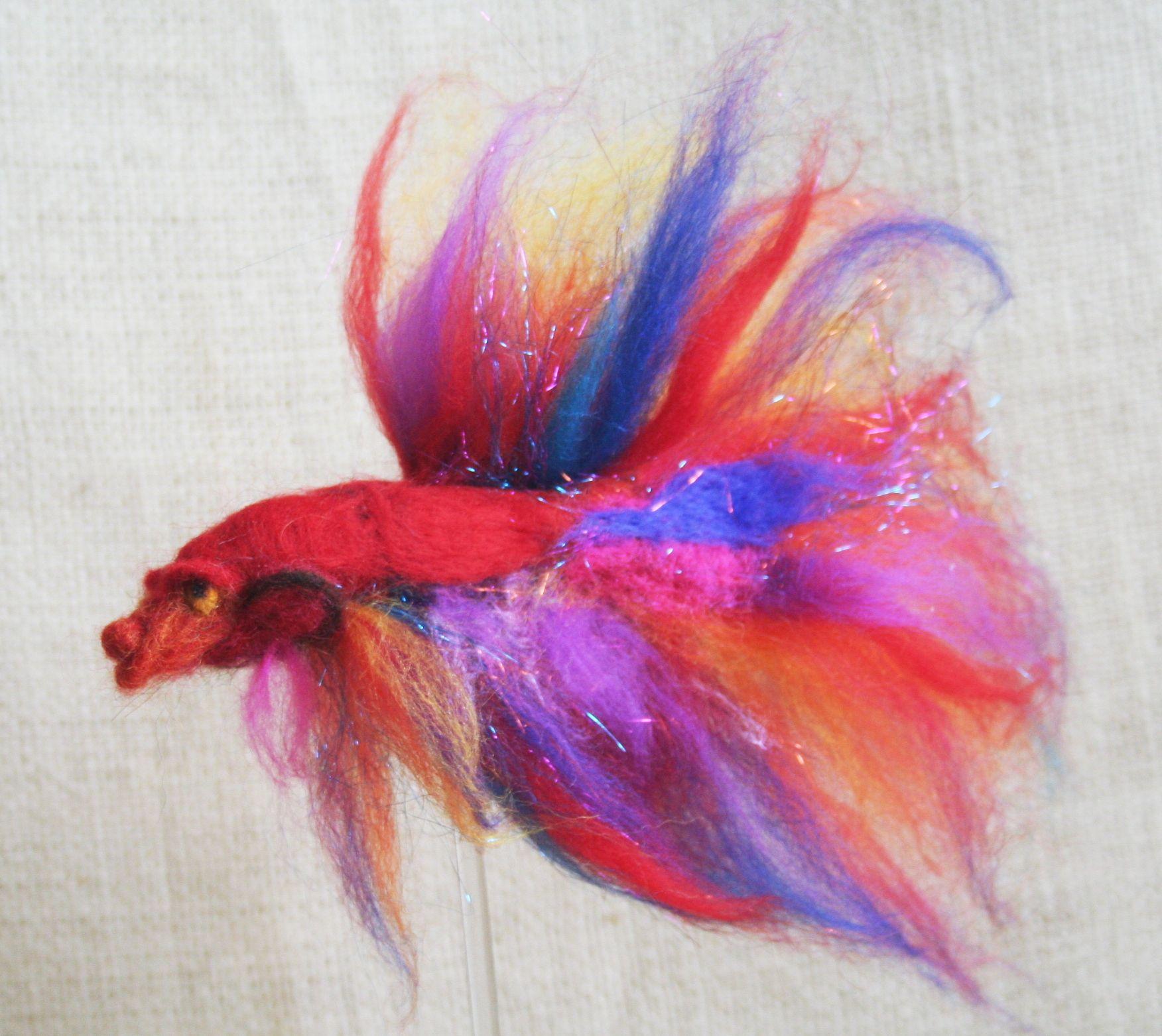 Vibrant and blazing with color, stunning lifelike betta fish; needle ...