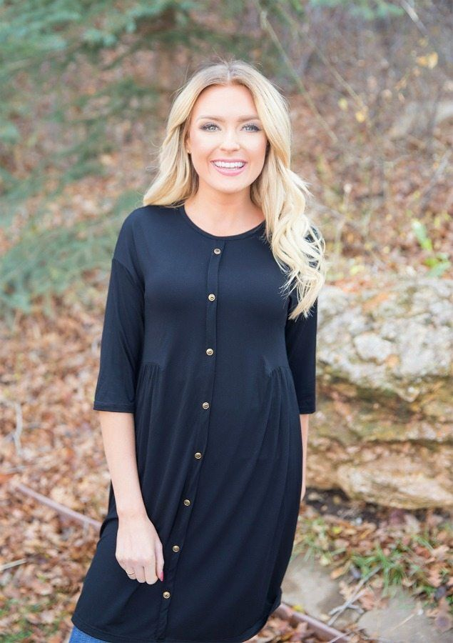 The darling Carmen Black Button Down Tunic Dress is a definite beauty. Any woman will look absolutely stunning in this gorgeous tunic dress. || Bella Ella Boutique