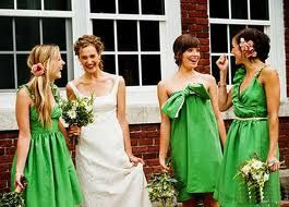 green bridesmaids gowns in different shapes