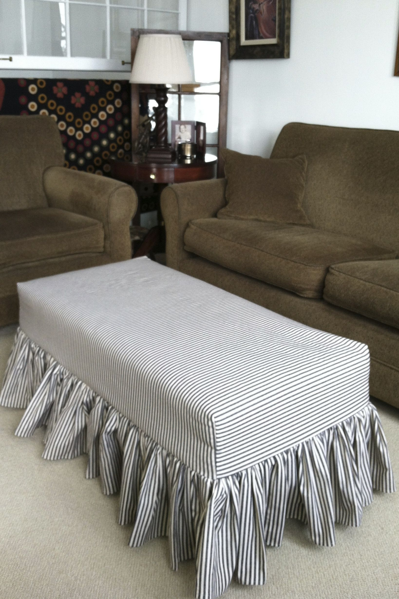 I love the ottoman slipcover i designed and sewed out of