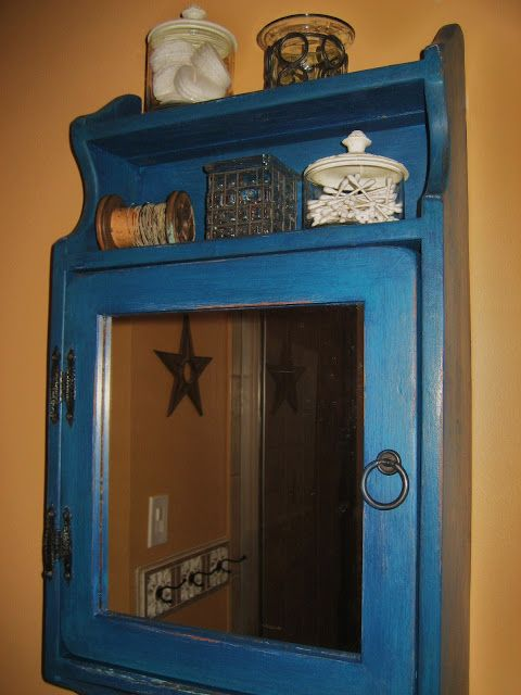 Ugly brownish medicine cabinet into cool blue rustic cabinet. I need something like this for my bathroom.
