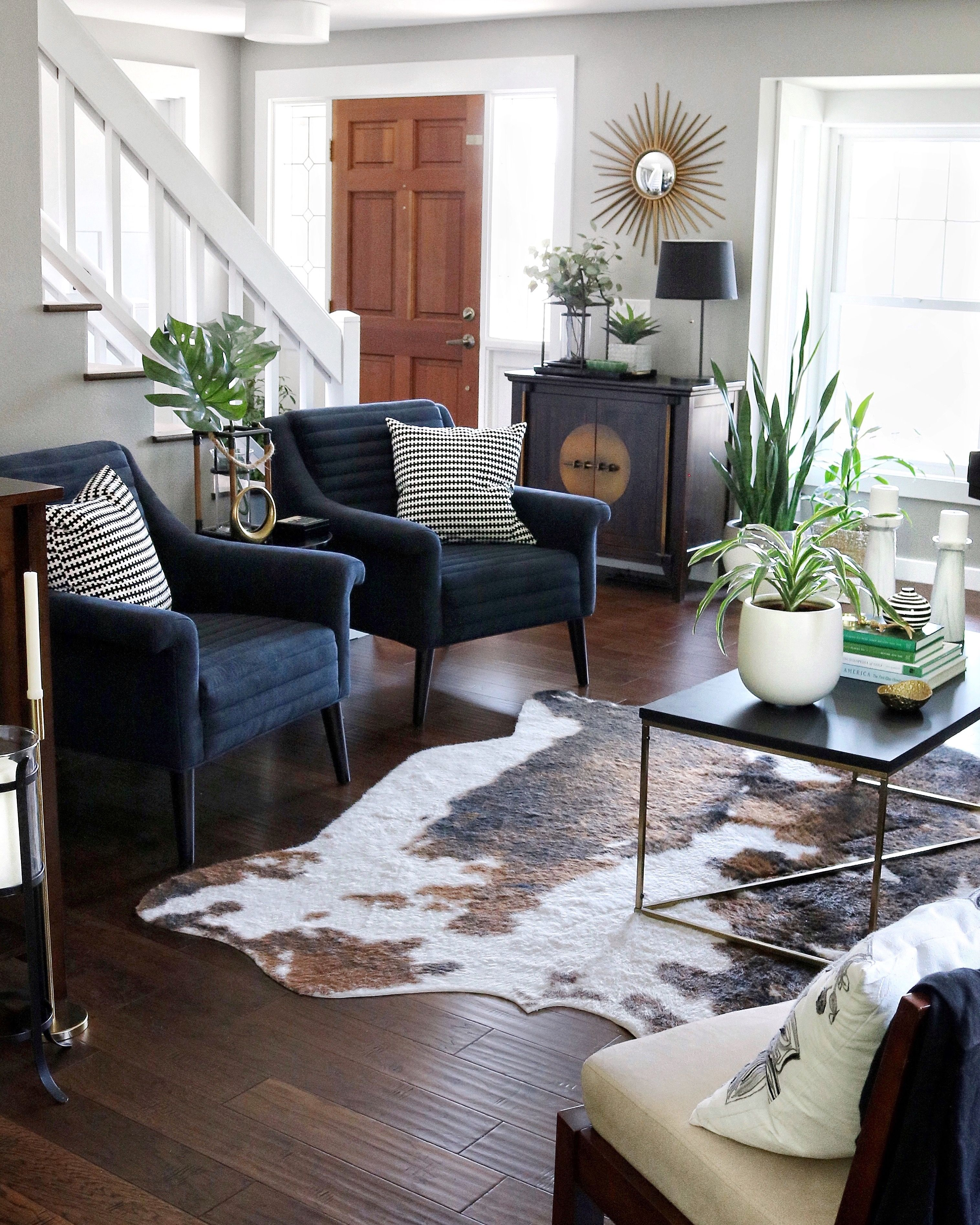Living Room With Navy Chairs Faux Cowhide Rug Rugs In Living Room Cow Rug Living Room Cowhide Rug Living Room