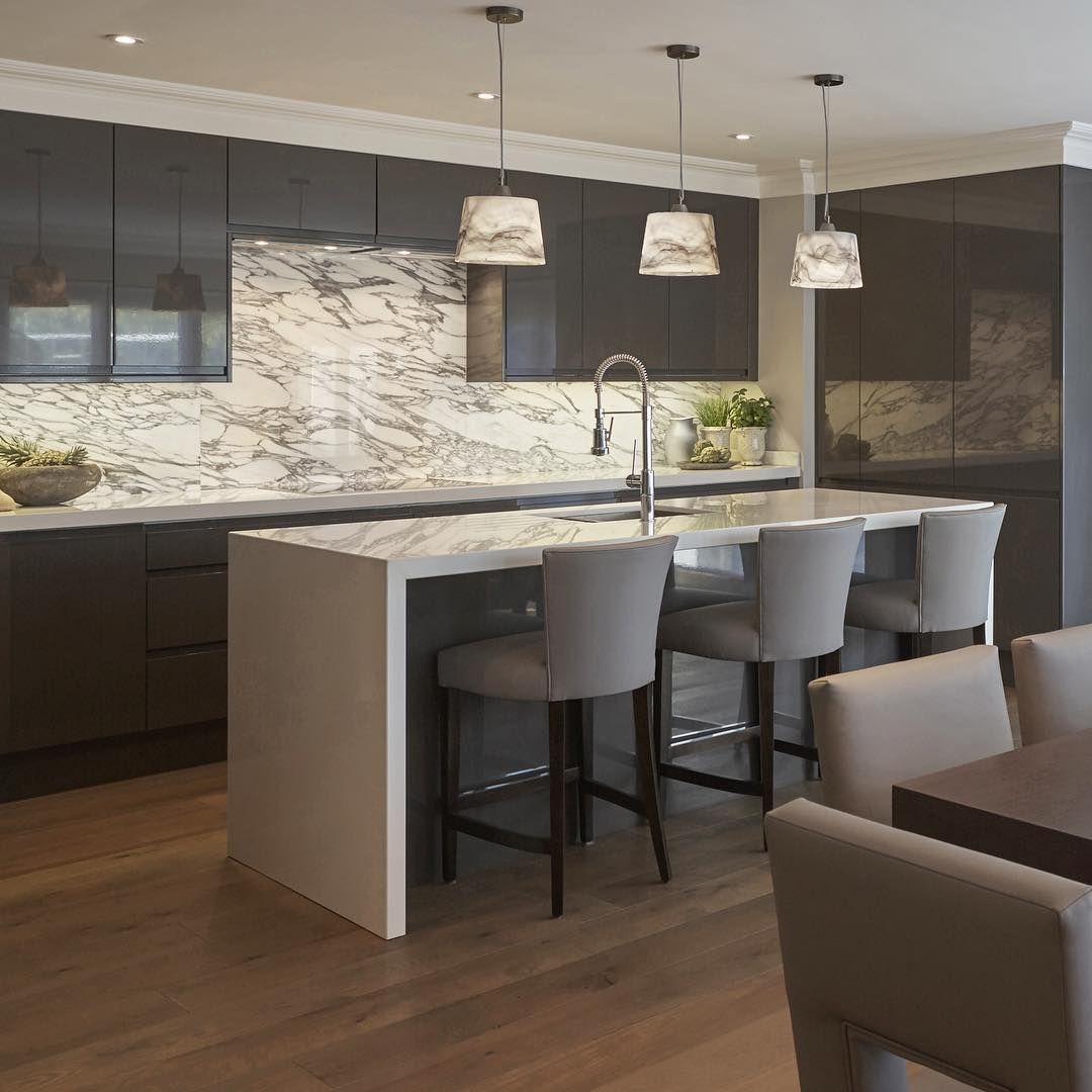 """In this kitchen we matched the Arabescato marble splash back to the light fittings for a statement design"""