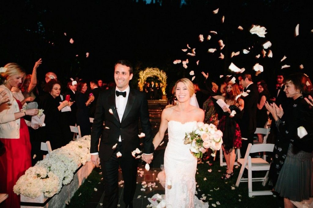 After the ceremony, the bride and groom walked down the  aisle under a shower of rose petals.