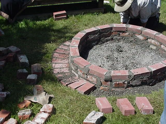 Diy brick fire pit we put pea gravel around the bricks for Brick fire pit construction