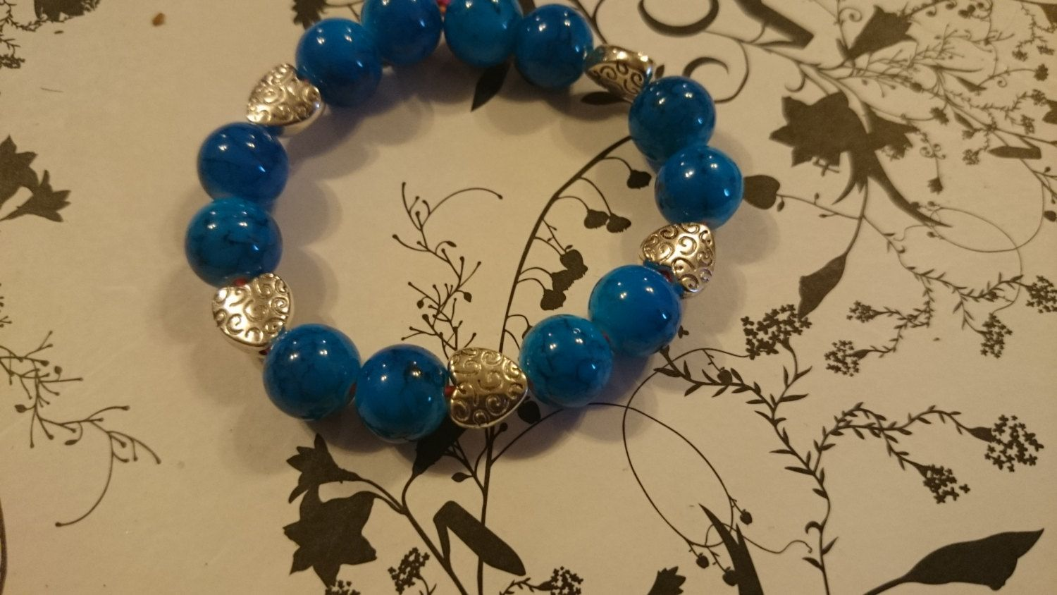 Beautiful Blue Beaded Bracelet with Patterned Heart Detailing by ShyamaBeautii on Etsy