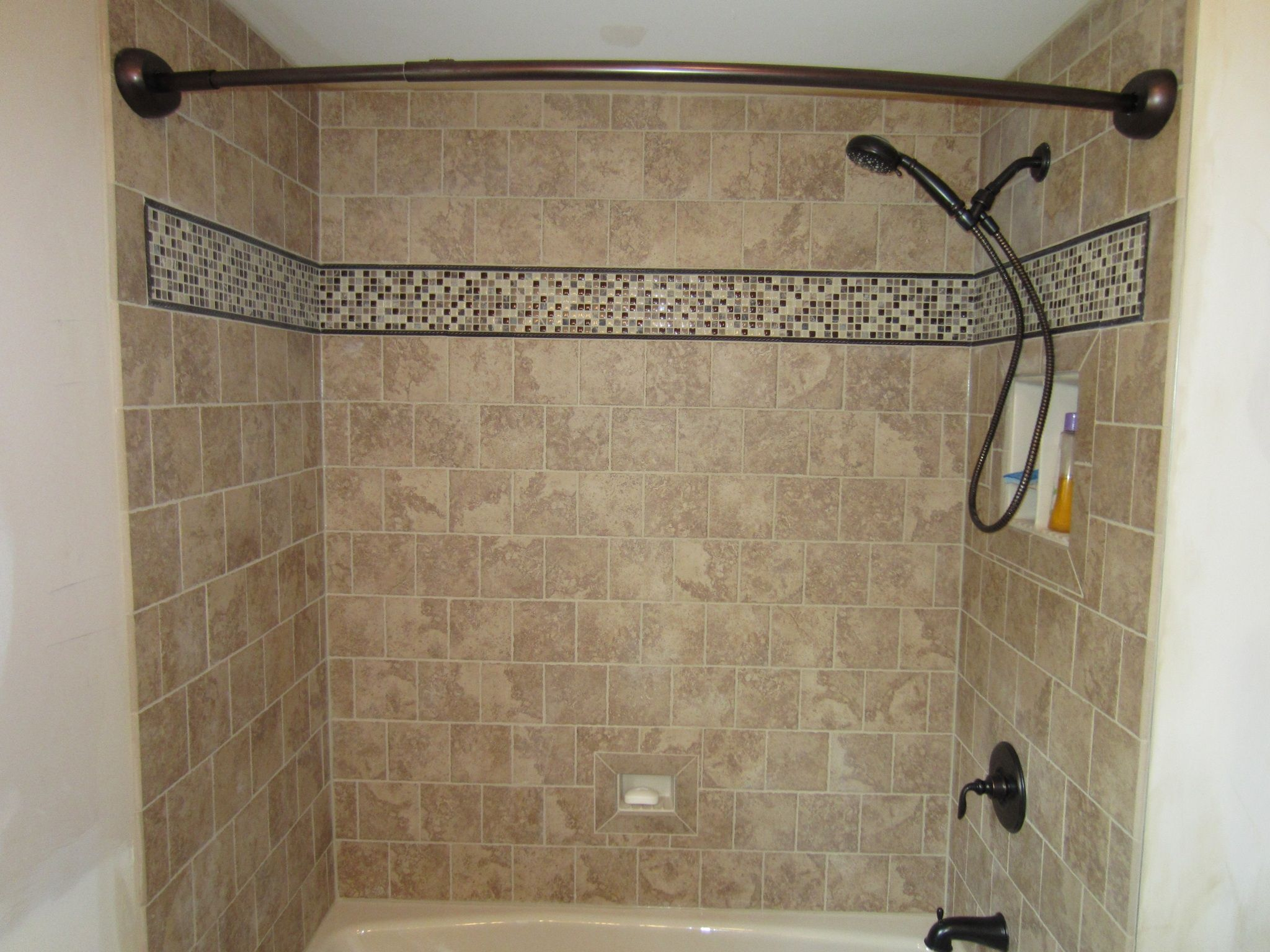We installed all new tiles on the wall, a new tub, recessed shower ...