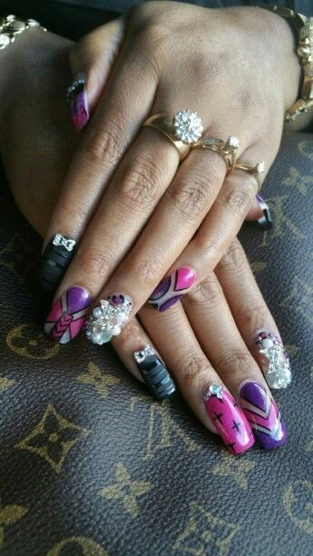 Nails by Kathy...LV crystals, black matte, crosses, and pink/purple designs. Lori Williams nails