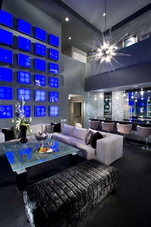 Contemporary Great Room with Hardwood floors, High ceiling, Modern Abstract Art Squares, Black storage bench, Chandelier