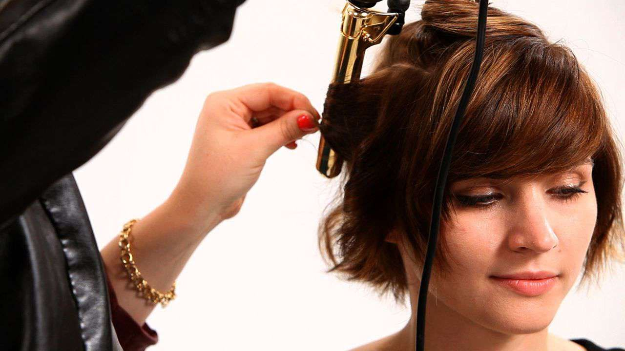 Learn to curl short hair with a curling iron using the