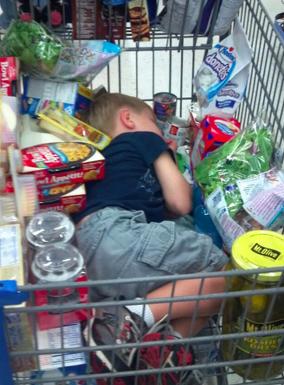 And the kid who can sleep anywhere. | 23 Kids Who Are Ready For This Shopping Trip To Be Over